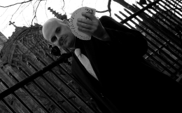 Magician David Fox performing a magic trick with cards outside of a London wedding venue.