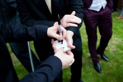 Magician David Fox performing an astounding signed card routine to amazed spectators at a wedding in central London.