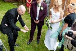 Wedding magician David Fox impressing guests in london with an outstanding close-up card magic routine.