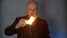 David Fox astounding guests at a party in the City of London with a fire to card transformation effect.