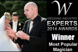 Magician David Fox amazing guests with a sleight-of-hand card trick in the grounds of a London wedding venue.